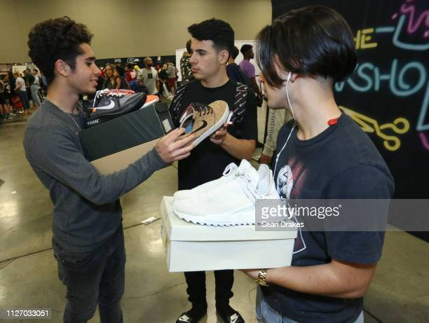 Teens discuss their sneakers for sale during SneakerCon 2019 at Fort Lauderdale Convention Center on February 2 2019 in Fort Lauderdale Florida
