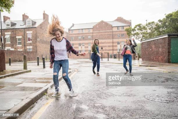 Teens Enjoying The Rain