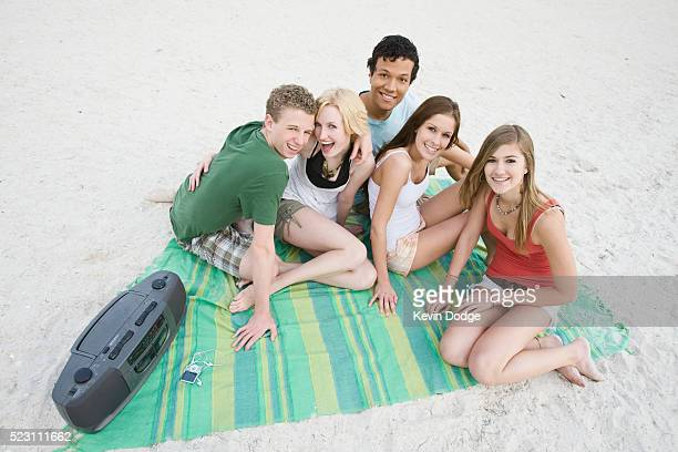 Teens Hanging Out on Beach