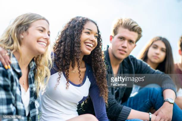 teens hanging out - teenagers only stock pictures, royalty-free photos & images