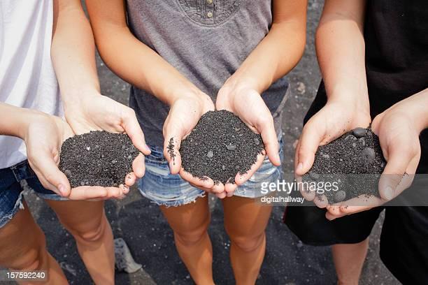 Teens holding Black Sand