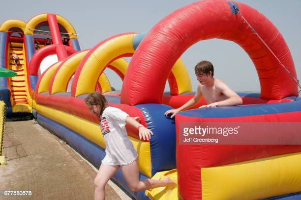 Teens playing on a waterslide at Maumee Bay State Park
