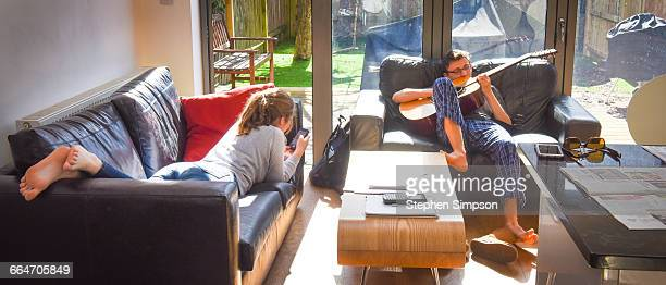 teens relax in sunny living room