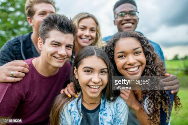 Teens smiling together for a group portrait