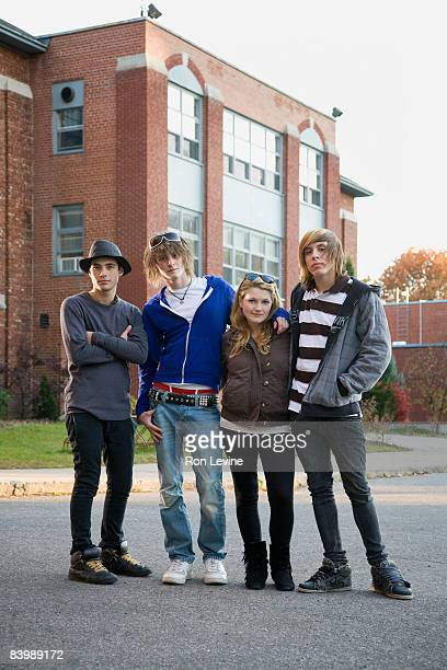 teens standing together outside high school - emo stock photos and pictures