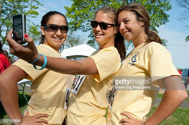 teens taking a cell phone photo - salem massachusetts stock pictures, royalty-free photos & images