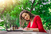 young woman student sitting wooden table