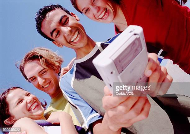 Teens Watching Friend Play Video Game