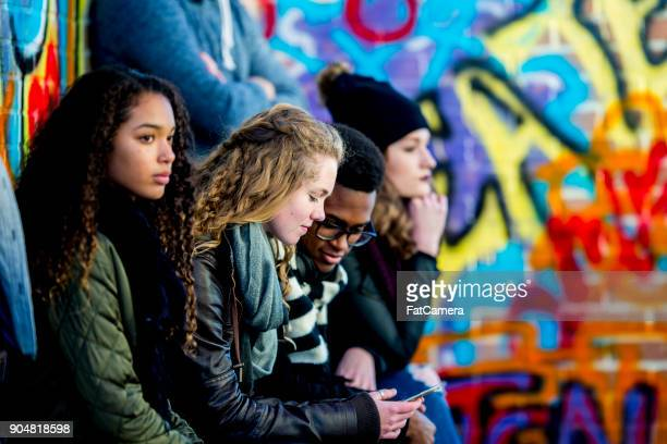 teens with technology - adolescence stock pictures, royalty-free photos & images
