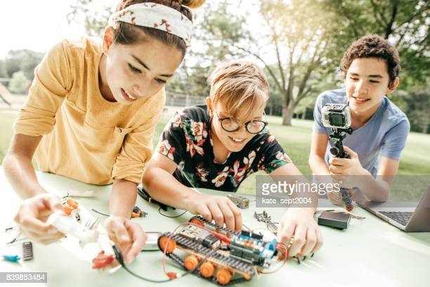 teens working on robotics project - vlogging stock photos and pictures