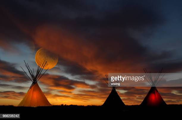 teepee camp at sunset with full moon - first nations stock pictures, royalty-free photos & images