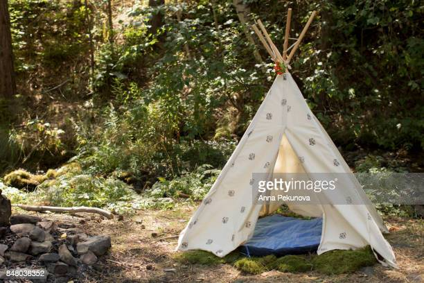 teepee in a forest - teepee stock photos and pictures