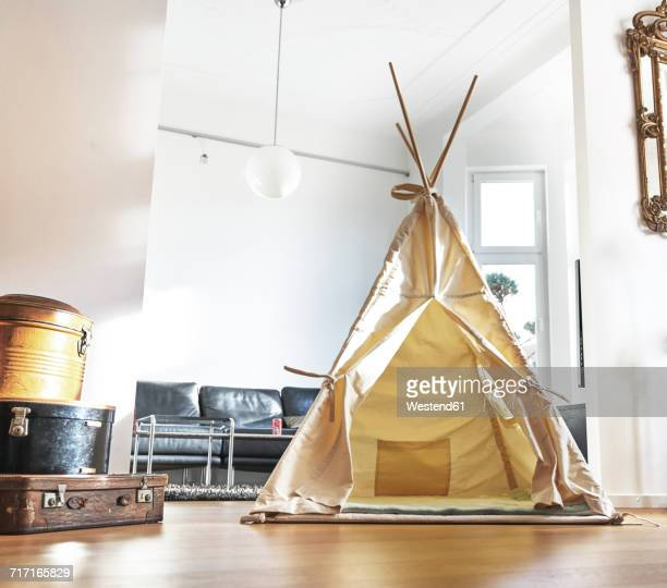 Teepee on floor in living room