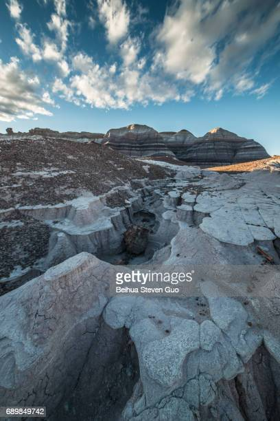 teepees formation during sunset with water drainage wash in petrified forest national park, arizona - petrified wood stock pictures, royalty-free photos & images
