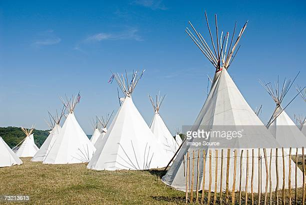 Teepees in a field