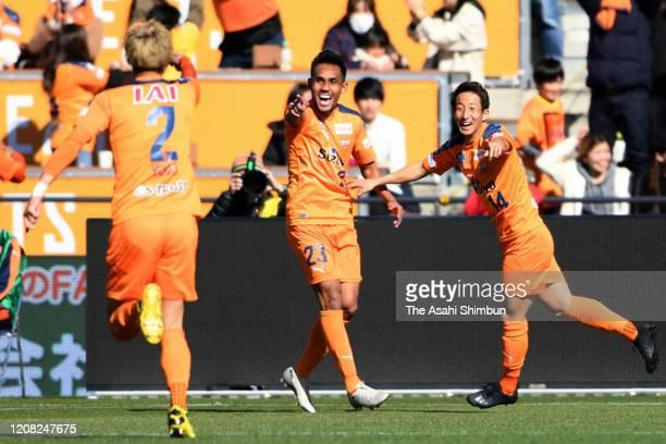 Teerasil Dangda of Shimizu S-Pulse celebrates scoring the opening goal with his team mates Yugo Tatsuta and Yusuke Goto during the J.League Meiji...