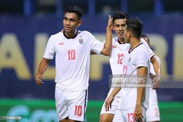 Teerasil Dangda of Thailand and Korrakot Wiriya-Udomsiri of Thailand in action during the international friendly match between Thailand and Congo at...