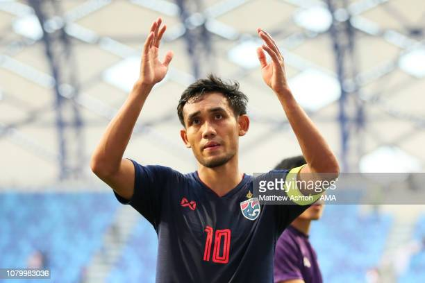 Teerasil Dangda of Thailand celebrates with his team-mates at the end of the AFC Asian Cup Group A match between Bahrain and Thailand at Al Maktoum...