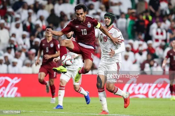 Teerasil Dangda of Thailand controls the ball during the AFC Asian Cup Group A match between the United Arab Emirates and Thailand at Hazza Bin Zayed...