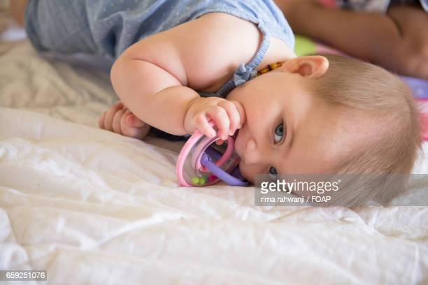 Teething ring in mouth of baby