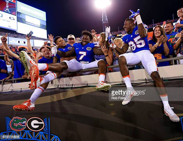 Teez Tabor Duke Dawson and Chris Thompson of the Florida Gators celebrate after the game against the Georgia Bulldogs at EverBank Field on October 29...