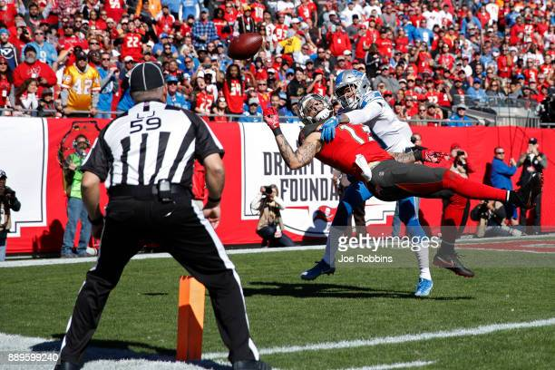 Teez Tabor of the Detroit Lions defends a pass in the end zone against Mike Evans of the Tampa Bay Buccaneers in the first quarter of a game against...