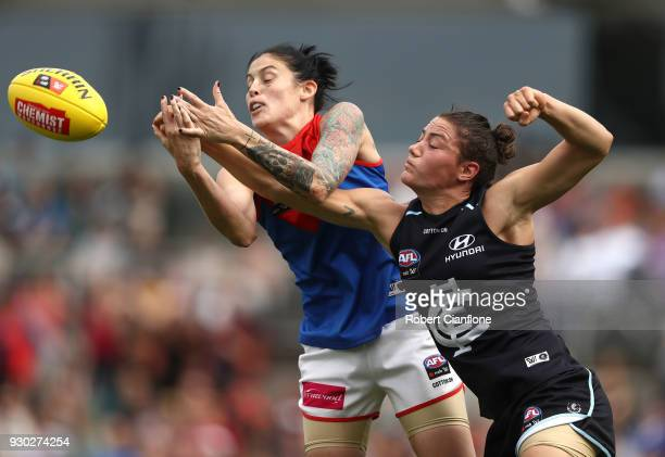 Tegan Cunningham of the Demons and Kate GillespieJones of the Blues compete for the ball during the round six AFLW match between the Carlton Blues...