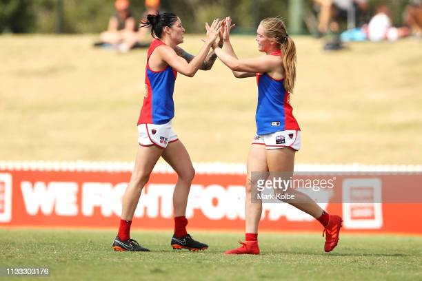 Tegan Cunningham of the Demons celebrates with her team mate Eden Zanker of the Demons after kicking a goal during the round five AFLW match between...