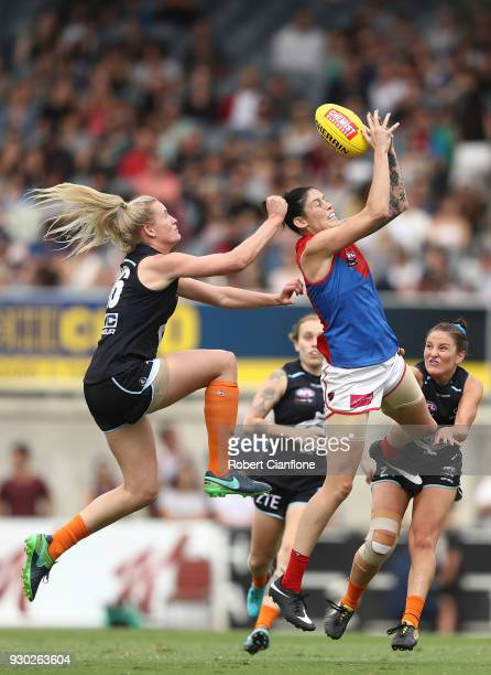 Tegan Cunningham of the Demons is challenged by Breann Moody of the Blues during the round six AFLW match between the Carlton Blues and the Melbourne...