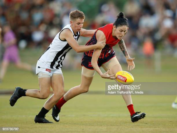 Tegan Cunningham of the Demons is tackled by Emma Grant of the Magpies during the 2018 AFLW Round 04 match between the Melbourne Demons and the...