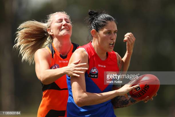 Tegan Cunningham of the Demons wins the ball over Tanya Hetherington of the Giants during the round five AFLW match between the Greater Western...