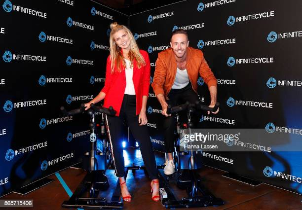 Tegan Martin and Donny Galella pose at the Infinite Cycle Launch Event on October 24 2017 in Sydney Australia