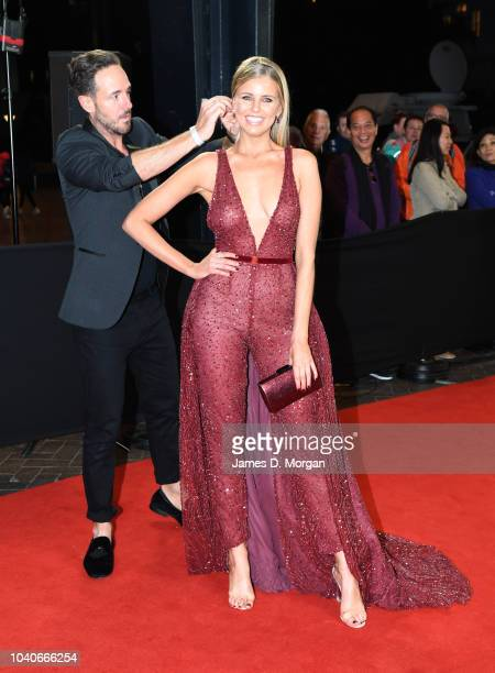 Tegan Martin is 'tweaked' on the red carpet by stylist Donny Galella as she attends the 2018 Dally M Awards on September 26 2018 in Sydney Australia