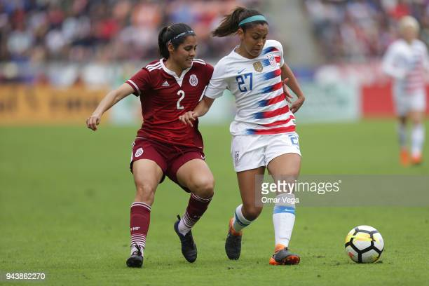 Tegan McGrady of United States and Kenti Robles of Mexico fight for the ball during the match between Mexico and United States at BBVA Compass...