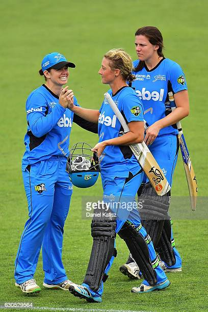 Tegan McPharlin congratulates Sophie Devine of the Adelaide Strikers on scoring the winning runs and reaching her century during the WBBL match...