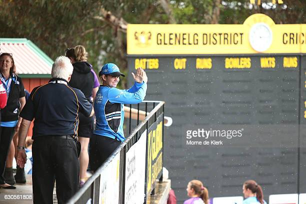 Tegan McPharlin of the Adelaide Strikers shows that the WBBL match between the Hurricanes and Strikers at Gliderol Stadium has been called off on...
