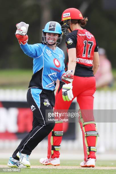 Tegan McPharlin of the Strikers celebrates a wicket of Amy Satterthwaite of the Renegades during the Women's Big Bash League match between the...