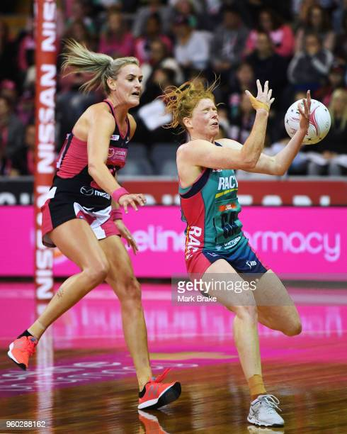 Tegan Philip of the Vixens catches in front of Leana de Bruin of the Thunderbirds during the round four Super Netball match between the Thunderbirds...