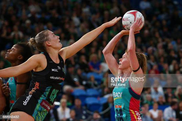 Tegan Philip of the Vixens looks to put up a shot against Courtney Bruce of the Fever during the round 14 Super Netball match between the Fever and...