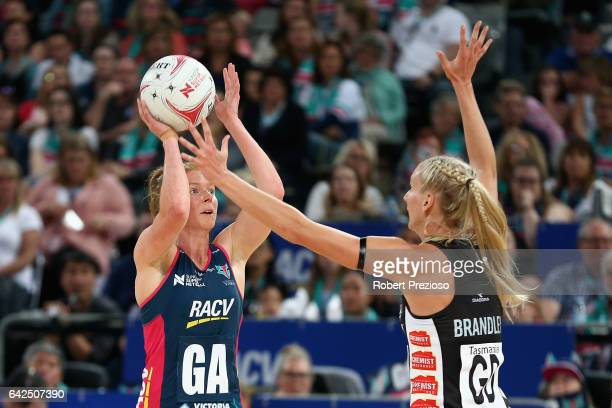 Tegan Philip of the Vixens makes a pass during round one of the Super Netball match between the Vixens and Magpies at Hisense Arena on February 18...