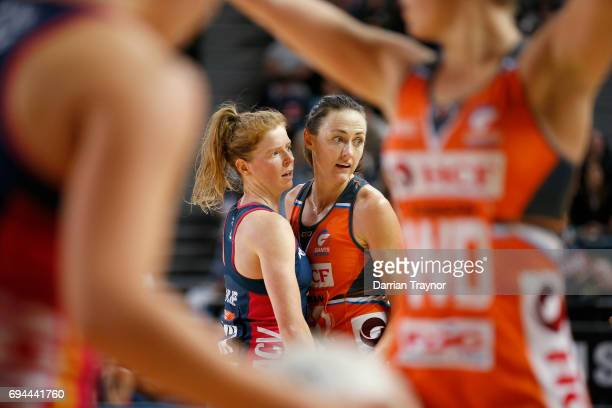 Tegan Phillip of the Vixens and Rebecca Bulley of the Giants compete during the Super Netball Preliminary Final match between the Vixens and the...