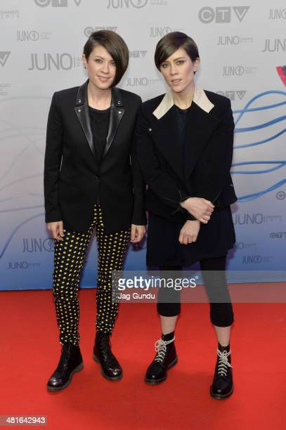 Tegan Quin and Sara Quin arrive at the 2014 Juno Awards on March 30 2014 in Winnipeg Canada