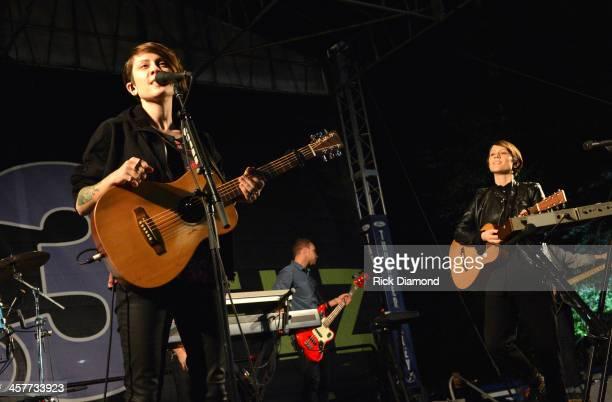"Tegan Quin and Sara Quin of Tegan and Sara perform at 933 FLZ's Jingle Ball ""PreShow Free Show"" on the Plaza 933 FLZ's Jingle Ball 2013 official..."