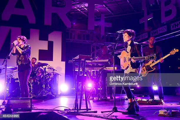 Tegan Quin and Sara Quin of Tegan and Sara perform at The Official VH1SCOPE Party on December 6 2013 in Miami Beach Florida
