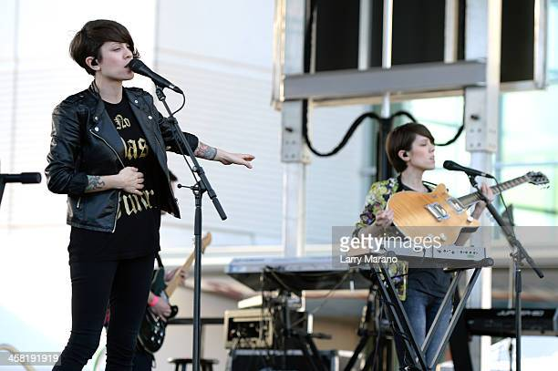 Tegan Quin and Sara Quin of Tegan and Sara perform at Y100's PreShow at the Jingle Ball Village on the plaza at the BBT Center on December 20 2013 in...