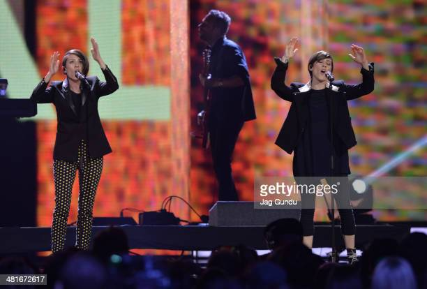Tegan Quin and Sara Quin of Tegan and Sara perform on stage at the 2014 Juno Awards held at the MTS Centre on March 30 2014 in Winnipeg Canada