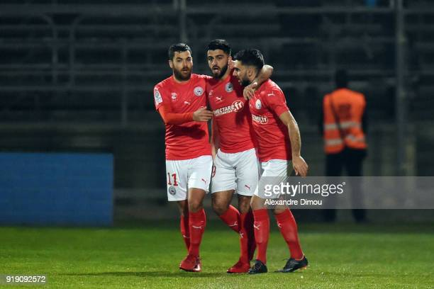 Tegi Savanier and Umut Bozok and Romain Del Castillo of Nimes celebrate the first goal during the French Ligue 2 match between Nimes and Tours at...