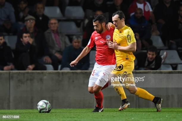 Tegi Savanier of Nimes and Julien Faussurier of Brest during the Ligue 2 match between Nimes Olympique and Stade Brestois at on October 20 2017 in...