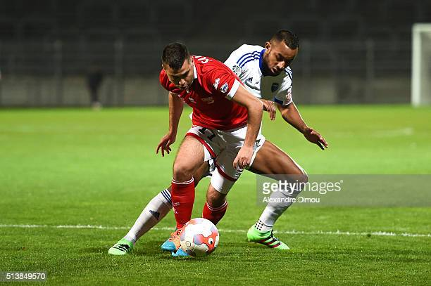 Tegi Savanier of Nimes and Loic Damour of Bourg en Bresse during the French Ligue 2 between Nimes v Bourg en Bresse at Stade des Costieres on March 4...