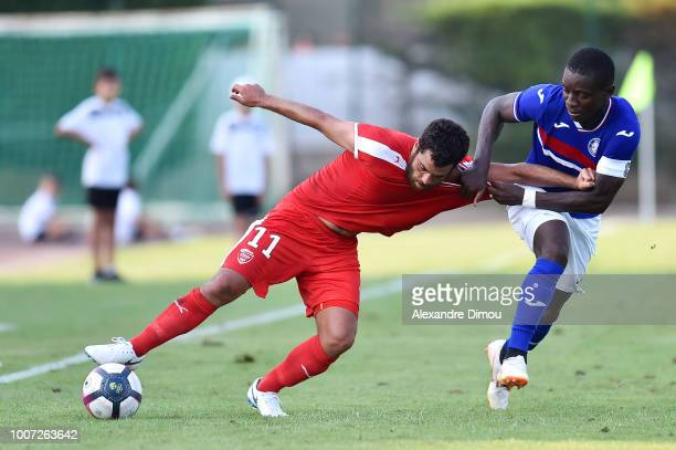 Tegi Savanier of Nimes and Max Alain Gradel of Toulouse during the friendly match between Nimes and Toulouse at Stade des Costieres on July 28 2018...